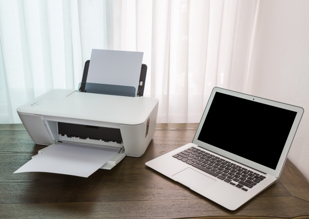 laptop wooden table with printer